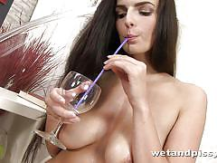 Sexy slut drinks her own pis with a straw