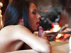 Couple having fun by the fireplace