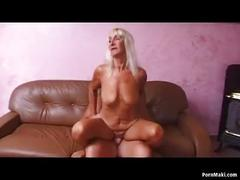 Blonde granny gets fucked on the table