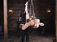 Limber milf gets suspended and caned