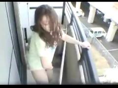 Asian girl masturbates on balcony