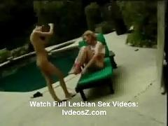 Two brunette lesbian whores eating pussy by the pool