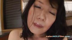 Mature woman fucking herself with vibrator in the...