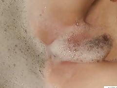Redhead mom pleasures her soapy pussy