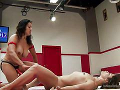 Hot lesbians fight it out in the wrestling ring