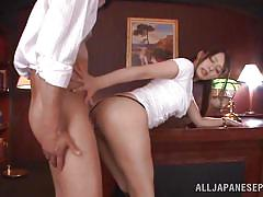 Japanese cutie sucks two cocks in the office