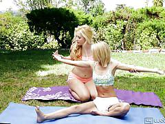 Young blondes have some fun in a park