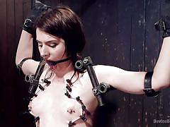 She is in a painful torture device