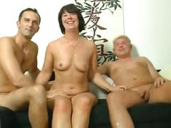Naughty german mom takes it by 2 guys on the couch