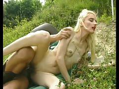 Skinny blonde gets fucked outside by cowboy