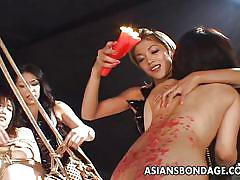Devilish asian mistresses punishing some hot chicks