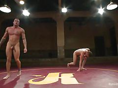 Muscled wrestler dominates his adversary in the arena