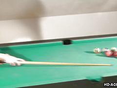 Alexis silver rolls balls on billiards table