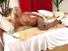 Sensual blonde in stockings masturbates for you