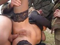 Girl gangbanged in grass by military men
