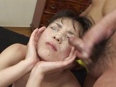 Young whore gets a face full of jizz and a cream pie