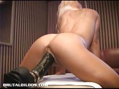 Jessy playing with a brutal dildo and squirting.