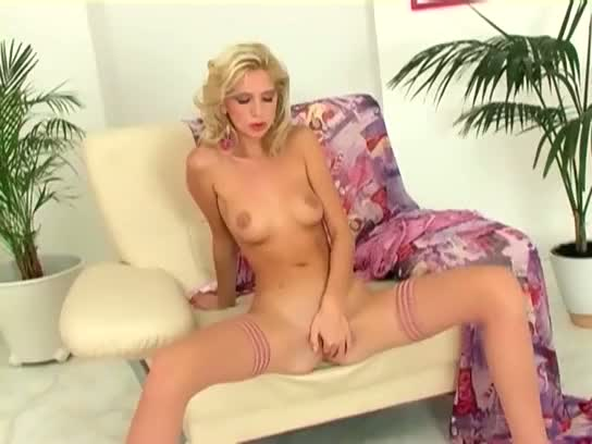 Petite blonde masturbates in stockings and heels
