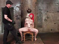 Tied up redhead gets orgasmic pleasures