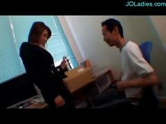 Office lady jerking off guy cock in the office while...
