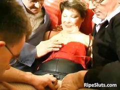 Horny mature slut gets fucked by two