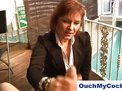 Mature boss lady gives lazy employee a harsh handjob