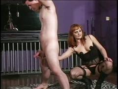 Plump whore in black lingerie man-handling her slave