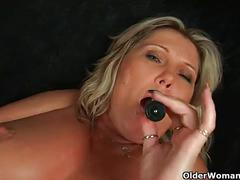 Sweet matured mom gitte with her heavy boobs fucks herself