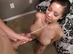 Asian babe jerks off a big cock