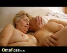 Two old grannies masturbate together on the couch