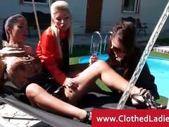 Opulent ladies having fun by the pool