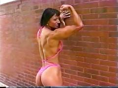 Fitness girl showing off great body outdoors