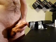 Guy using fleshlight and wanking. great cumshot at the end. (with sound)