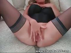 Busty amateur milf in stockings toying with her shaved pussy
