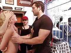 Blonde woman is humiliated and made to suck on cock in shop