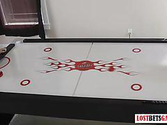 Strip air hockey game gets rambunctious