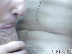 Sucking on the prick and she loves it