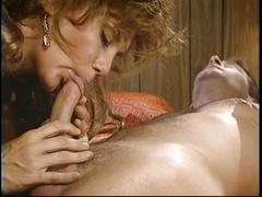 Brunette gives blowjob in bedroom