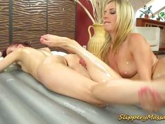 Slippery massage for two horny lesbian babes