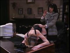 Slut spanked on desk with paddle