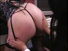 Slut spanked on desk with paddle