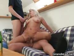 Grandma sucks and rides two cocks