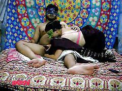 Masked indian sucks on a stiff cock