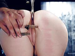 Clothespins biting in her pussy flesh