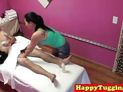 Asian masseuse with firm tits blowing her client