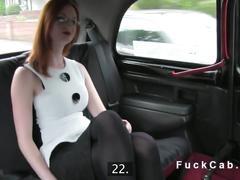 Redhead flashing pussy in a british fake taxi