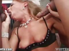 Blonde slut sucks on three huge cocks