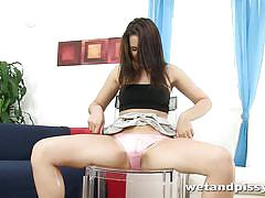 Sexy brunette squirts on the table