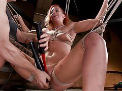 Tied redhead babe gets some vibrator play