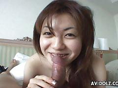 Asian babe sucking hard on a fat dick like a whore